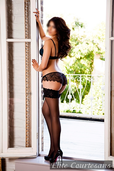 May stood posing in a doorway in black lingerie and heels.