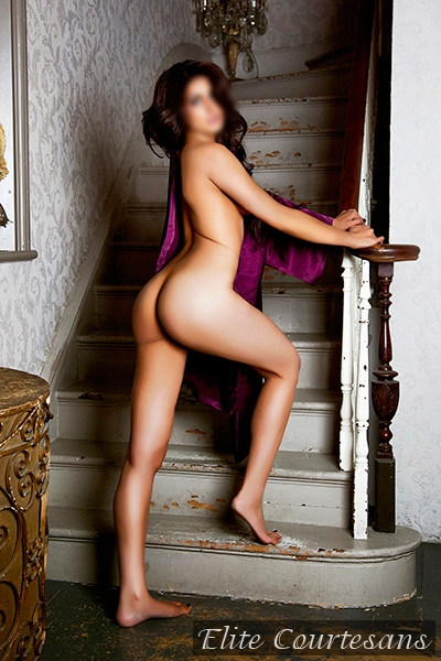 May climbing the stairs of her Birmingham apartment naked.