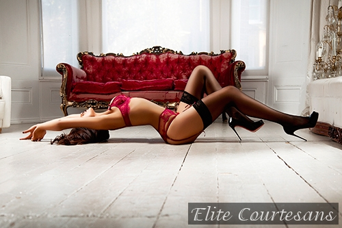 May lying on the floor of her Midlands home looking sexy.