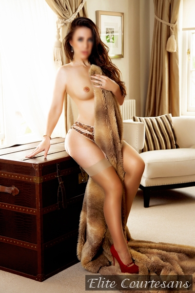 Laura standing topless enjoying the feel of real fur