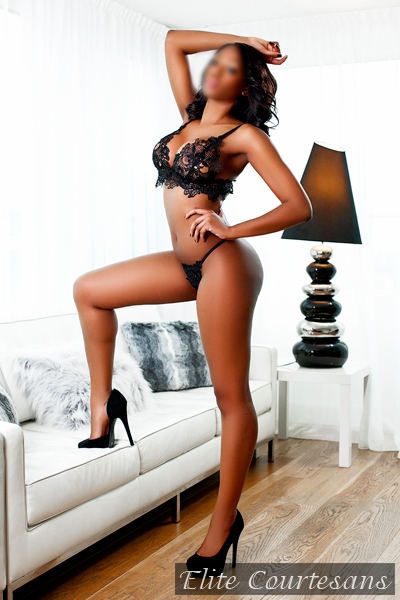 High class British black escort posing at a luxury west end Penthouse apartment