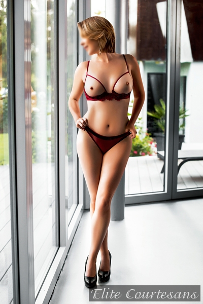 Sussex & Surrey Milf Escort in red lingerie