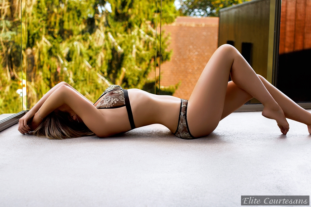 Tess Brighton Escort lying down sensually at a sussex holiday home
