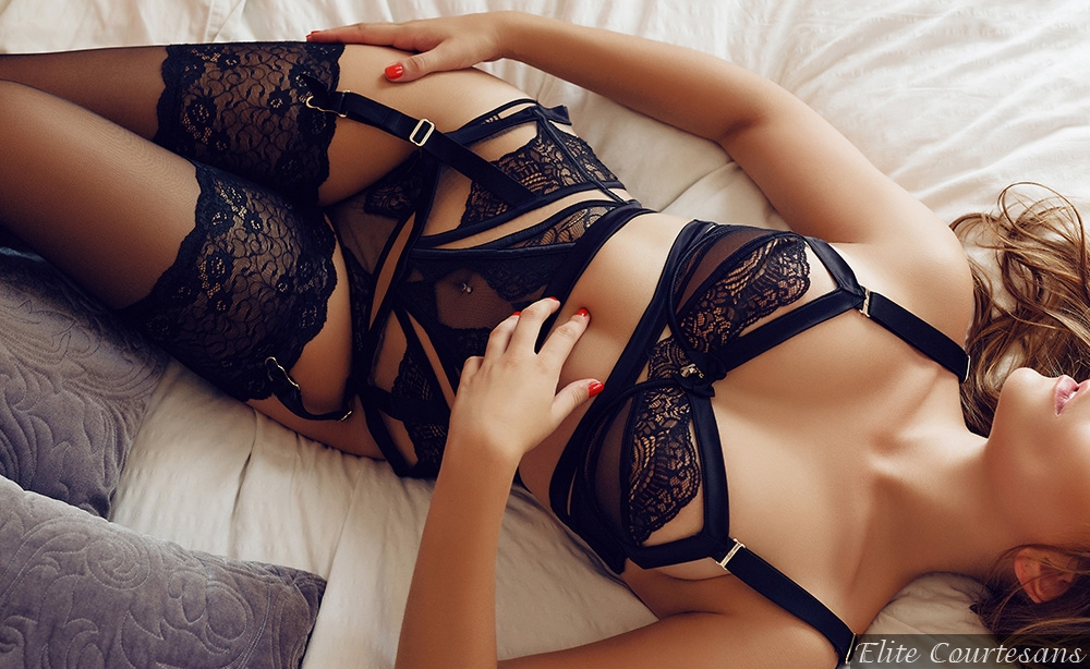 High class Nottingham escort in only the finest black lingerie, stockings and suspenders.