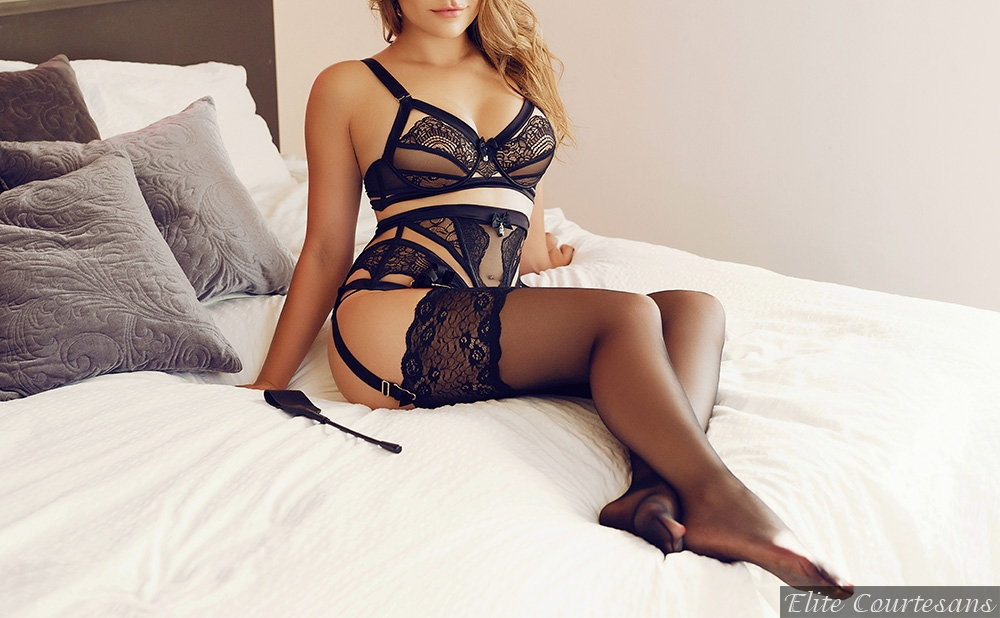 Lying on the bed in the Hyatt Hotel Birmingham, in fully fashioned stockings and stunning black underwear, long light brown hair tumbling over her shoulders.