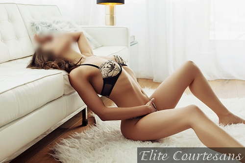 Looking radiant sat on the floor of her Bristol apartment, brunette escort Jade in the South West.