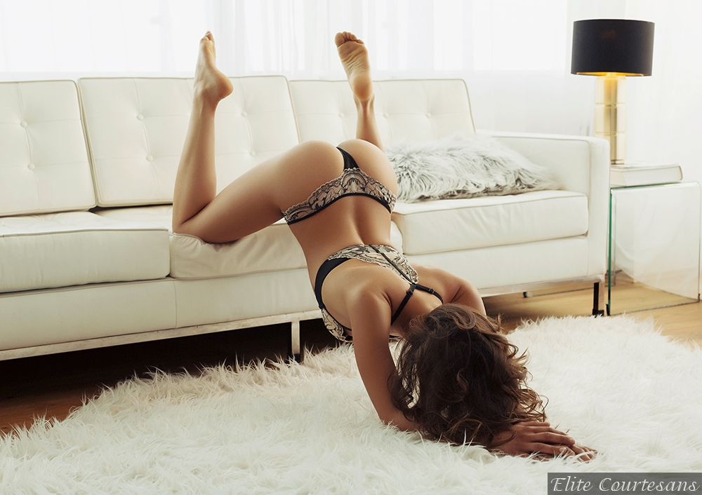 Cheltenham escort Jade in pretty lace knickers and bra showing us how NOT to sit on a sofa.
